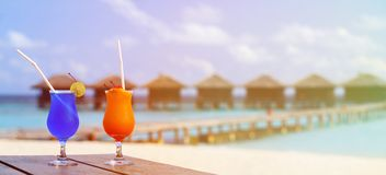 Two cocktails on luxury tropical beach resort. Wide panorama Stock Image