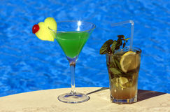 Two cocktails by the pool. On the table Royalty Free Stock Photos