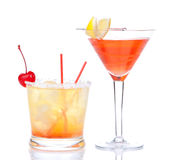Two cocktails red alcohol cosmopolitan cocktail decorated. With citrus lemon in martini cocktails glass and yellow summer margarita isolated on a white royalty free stock image