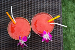 Two cocktails with strawberry and orchid flower Stock Photography