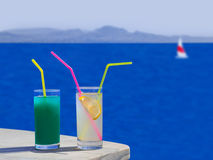 Two cocktails on table at beach Royalty Free Stock Images