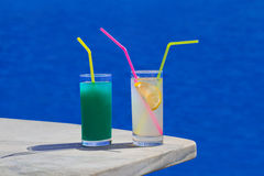 Two cocktails on table at beach Stock Image