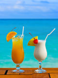 Two cocktails on table at beach cafe stock photo