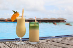Two cocktails on tropical beach Royalty Free Stock Photos