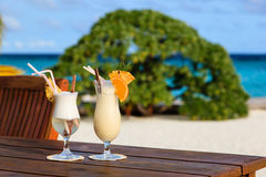 Two cocktails on tropical beach Stock Images