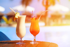 Two cocktails on tropical beach resort. Two cocktails on luxury tropical beach resort Royalty Free Stock Photo