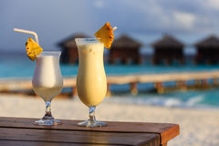 Two cocktails on tropical beach Stock Photos