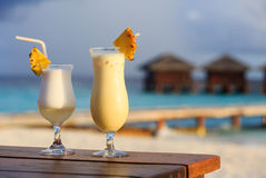Two cocktails on tropical beach Royalty Free Stock Photography