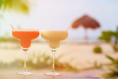 Two cocktails on tropical sand beach Royalty Free Stock Images