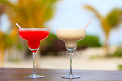 Two cocktails on tropical sand beach Stock Images