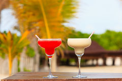 Two cocktails on tropical sand beach Royalty Free Stock Photography