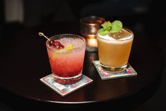 Two cocktails on wooden table Stock Images