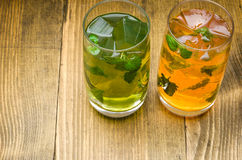 Two cocktails yellow and green. Ice Stock Images