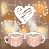 Two cocoa or coffee cups and white hatching heart. Two cocoa or coffee cups with knit cover and white hatching heart on blurred background with glitters. Vector Royalty Free Stock Image