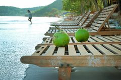 Two coconut drinks on the Beach chair Royalty Free Stock Images