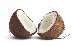 Two coconut halves on white. Fresh coconut halves on white background Stock Photos