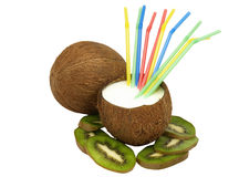 Two coconut with a kiwi and cocktail straws. Royalty Free Stock Photos