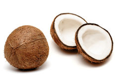 Two coconuts, one cracked. One cracked  and one unbroken coconuts isolated on white Stock Images