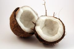 Two coconuts on white background. Two pieces of coconut on white background. Isolated, close up picture Royalty Free Stock Images