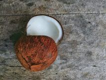 Two Coconuts on wooden background. For cooking Royalty Free Stock Photos