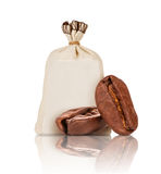 Two coffee beans closeup and bag with coffee on white background Stock Photography