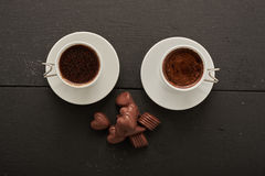 Two coffee with chocolates Stock Images