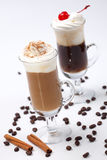 Two Coffee Cocktail - Coffee Warmers. Two glasses of tasty Coffee Cocktails with whipped cream and maraschino cherry - Coffee Warmers series royalty free stock image
