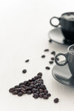 Two coffee cup and spilled coffee beans Royalty Free Stock Photo