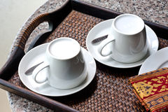 Two Coffee Cup in Woven Tray Royalty Free Stock Image