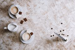Two coffee cups on a bright vintage background stock image
