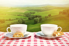 Two coffee cups and cantuccini on the table Stock Photos