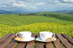 Two coffee cups and cantuccini on the table Stock Photo