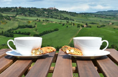 Two coffee cups and cantuccini on the wooden table Stock Image
