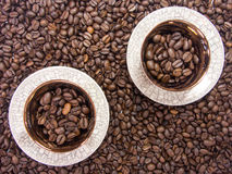 Two coffee cups coffee background. With beans Royalty Free Stock Photography