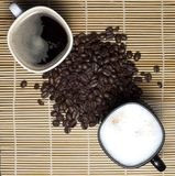 Two coffee cups and coffee beans Royalty Free Stock Photo
