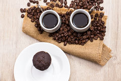 Two coffee cups with coffee beans Royalty Free Stock Images