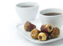 Two coffee cups and dates. Stock Photography