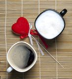 Two coffee cups and heart Stock Image
