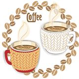 Two coffee cups with knit sleeve Stock Image