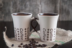 Two coffee cups. Two modern espresso cups on a wooden table Royalty Free Stock Photography