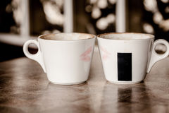 Two coffee cups with red hearts Royalty Free Stock Photo
