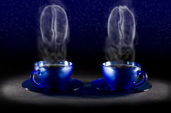 Two coffee cups. With steam in the form of coffee beans Royalty Free Stock Image