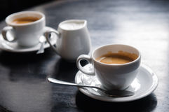 Two coffee cups on table in cafe Royalty Free Stock Photo