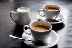 Two coffee cups on table in cafe Royalty Free Stock Images