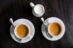 Two coffee cups on table in cafe Stock Images