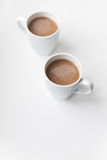 Two coffee cups. Two white coffee cups on the white table Stock Photo