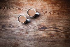 Two coffee cups. Two white coffee cups on the wooden table Stock Images