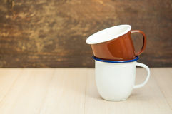 Two coffee cups. Two coffee cups on wooden table Royalty Free Stock Photos