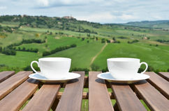 Two coffee cups on the wooden table Royalty Free Stock Photography