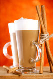 Two Coffee Latte With Cinnamon Sticks Royalty Free Stock Photos